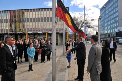 Mr Rod Little, Chair ACT Aboriginal and Torres Strait Islander Elected Body raises the Aboriginal flag. Photo by Silas Brown