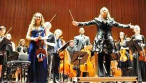 Retiring concert master Natalia Harvey and conductor Rowan Harvey-Martin with orchestra