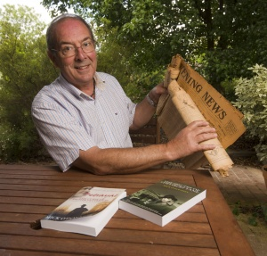Duffy author Mick O'Donnell with old newspaper clippings he found that led him to write his latest book. Photo by Gary Schafer