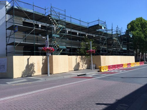 Hoardings and scaffolding protect the fire-damaged part of the Sydney Building.
