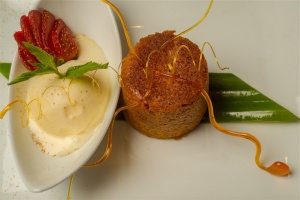 Steamed treacle cake with vanilla ice cream. Photo by Gary Schafer