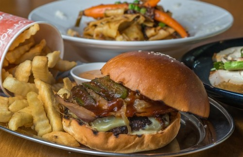 The Brooklyn burger – dry aged beef with bacon, pickles confit onions, cheddar and house barbecue sauce. Photo by Gary Schafer