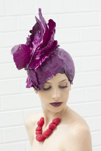 Fashfest is working with The Forage to host a live food-themed photo shoot.… model Ella Mathews rehearses with an exquisite hat of bright purple cabbage and a necklace of plump red raspberries around her neck. Photo by Jessica Rue