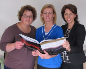 Prize winners... from left, photographer Trudy Taylor, author Nichole Overall and   designer Dana Stewart-Thompson