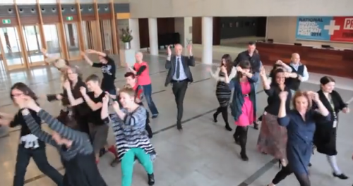 Dancing gallery staff including (centre)  director Angus Trumble