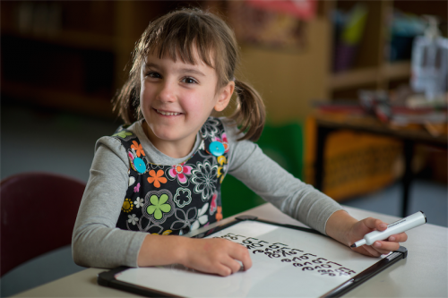 Five-year-old kindergartner Rosie Vukovljak practises her writing at the O'Connor Cooperative School. Photo by Gary Schafer