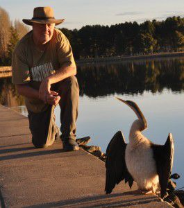 The Canberra Ornithologists Group vice president, Neil Hermes, with an Australian darter.