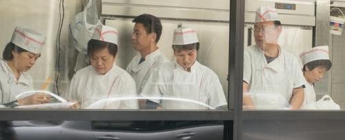 The CBD Dumpling House kitchen team busily making dumplings. Photos by Gary Schafer
