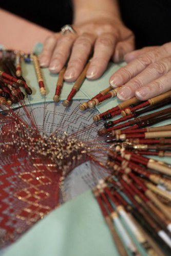 Craft on show -  Helen Mewett's red Torchon fan