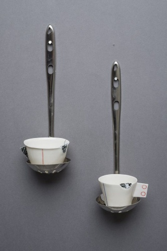 2 cups on stainless steel spoons