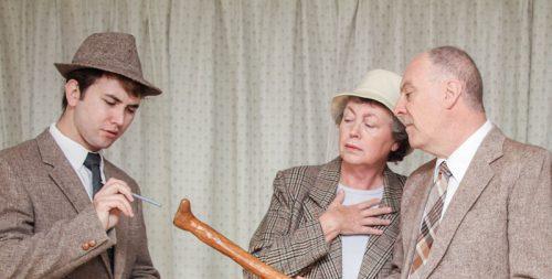 Constable Jones (Sam Kentish), Mildred (Marian FitzGerald) and  Sir Roland Delahaye (Kim Wilson) check the evidence.
