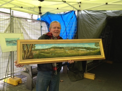 Cranston with one of his own paintings