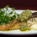 Wild Barramundi - Fillet of barramundi panfried in fresh herb set on leeks and potato mash top with salsa verde