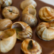 Escargots a La Bourguignonne, cooked in garlic and herb butter…  luxurious on the first visit. Photo by Andrew Finch