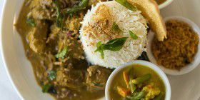 Beef curry with Sri Lankan-style rice… like a mini buffet on a plate, with a couple of curries, rice, coconut sambol and thin, crispy pappadam.
