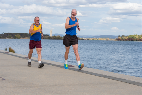 Racewalkers Geoff Barker, left, and Robin Whyte, who used to walk from Parkes to Belconnen most mornings during his working life. Photo by Andrew Finch
