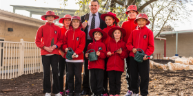 Getting ready for Schools Tree Day... Mirko Milic with Aranda Primary School students, from left, Charlotte, Miranda, Thomas, Kayd, Frankie, Kairlyn, Emma and Kevin.