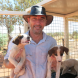 Dr Michael Archinal in the process of transporting some young dogs to and from the surgical facility for their desexing.