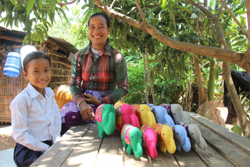 Seamstresses Saney, from Siem Reap, near Angkor Wat, has developed a successful sewing business at her home.