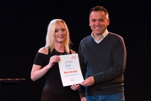 Kirsty Budding receives her award from Minister Bourke