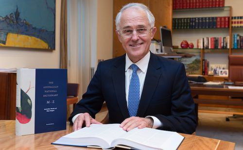PM Malcolm Turnbull with his new dictionaries.