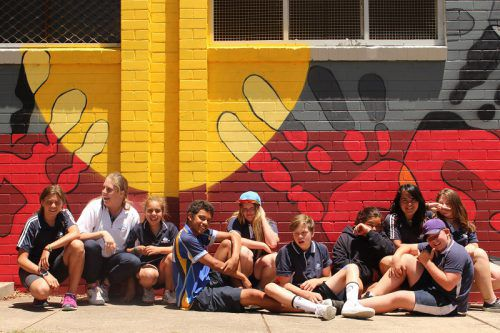 Happy artists at Kippax with the mural