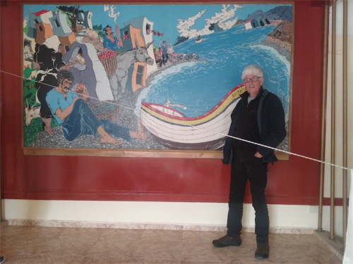 Artist Michael Winters with his 1982 restaurant mural.