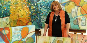 Tracey Creighton with 'Unleashing the Flood' paintings.