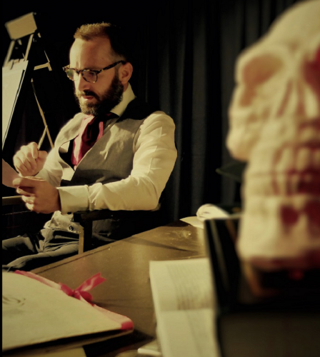 Lawry as Screwtape in his study