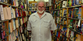 "Bookshop owner Ron Robertson… ""I haven't had a holiday in seven years. I only take public holidays off."" Photo by Danielle Nohra"