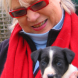 2010 and Suzanne ignores the advice and picks up puppy Ella. Photo by Heike Harner