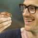 ANU PhD student Ian Brennan with an Underwoodisaurus gecko. Image: Stuart Hay, ANU.