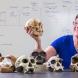 Dr Debbie Argue holds reconstructed Homo Floresiensis skull - Credit Stuart Hay - ANU
