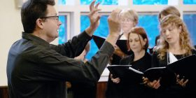 Peter Young conducting the chorale, photo Peter Hislop