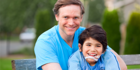 bigstock-Handsome-Father-Holding-Smilin-67020319