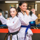 United Taekwondo junior black belt Hallie Canning, 10, left, and Kyokushin karate gold medal winner Mary Vella, 10. Photo by Maddie McGuigan