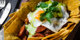 """Huevos Rancheros"" (Rancher's Eggs)... a traditional Mexican farmer's breakfast of chorizo, beans, corn, avocado, herb crema and corn chips all topped with a fried egg. Photo by Maddie McGuigan"