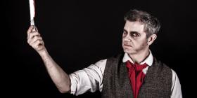 "Baritone David Pearson in the title role of ""Sweeney Todd""."