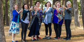 The Singed Sisters, from left, From left: Suzanne Kukolic, Liz Tilley, Karen Downing, Alison Mills, Julie Pham, Jane Fitzgerald and Liz Walter. Photo by Maddie McGuigan