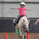 Blind from birth, 5 year old Mieah goes to riding lessons at Pegasus, a riding school for the disabled in Canberra.  Photo by Jane Dempster.
