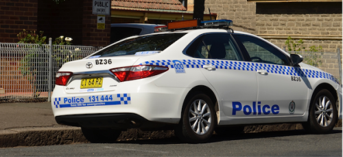 Man drives ute at police officer