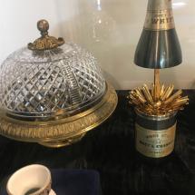 Partof chandelier, Moet cigarette case,stolen eggcup