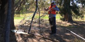 Environment Protection officer Tim Gibb removes an illegal fish trap from Lake Burley Griffin.