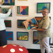 Dr Kathryn Spurling, left, and Margaret Hadfield with paintings they salvaged by Ainslie artist Lindsay Cameron-Smith. Photo by Kathryn Vukovljak