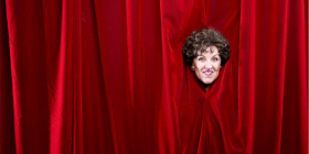"Queenie van de Zandt in her new show ""Parting the Red Curtains""."