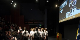 Woden Valley Youth Choir perform at the opening of 'Another Day in Paradise'  photo  by Martin Ollman