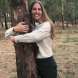 """Tree-hugging Samantha Ning... """"I just love trees. They make you feel good, they look beautiful, they're air conditioners, they filter pollution, they bring so many benefits."""" Photo by Kathryn Vukovljak"""