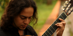 Guitarist Chrystian Dozza... his ability to switch from one plucked harmonic note to a full-on fortissimo strum is seamless,.