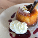 Pretty on the plate… orange almond cake with a berry coulis, whipped cream and a candied slice of orange dipped in chocolate. Photo by Wendy Johnson