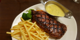 The sirloin steak at Caphs… they certainly got the protein right, but Wendy couldn't say the same with the veggies and fries. Photo by Wendy Johnson